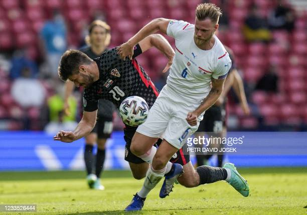 Croatia's forward Bruno Petkovic vies with Czech Republic's defender Tomas Kalas during the UEFA EURO 2020 Group D football match between Croatia and...