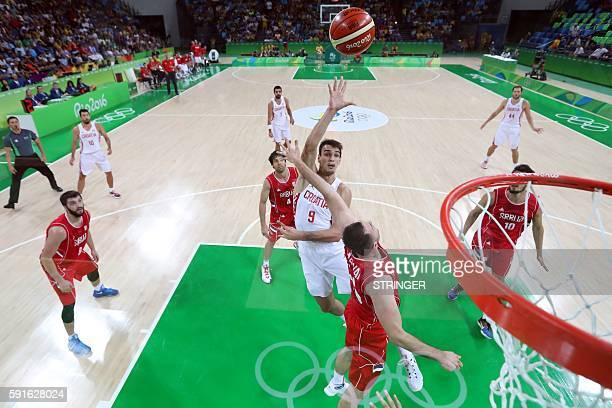 Croatia's forward Dario Saric takes a shot during a Men's quarter final basketball match between Croatia and Serbia at the Carioca Arena 1 in Rio de...
