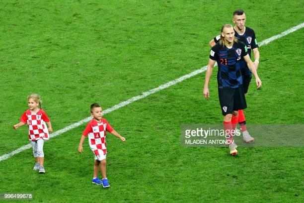 Croatia's forward Ivan Perisic and Croatia's defender Domagoj Vida celebrate after winning the Russia 2018 World Cup semifinal football match between...