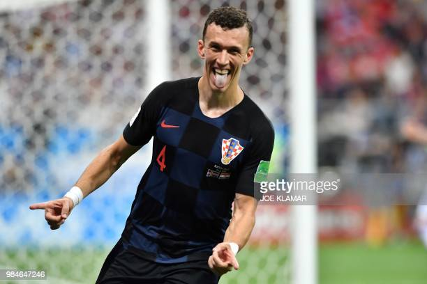 TOPSHOT Croatia's forward Ivan Perisic celebrates after scoring his team's second goal during the Russia 2018 World Cup Group D football match...