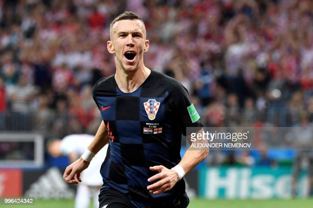 TOPSHOT Croatia's forward Ivan Perisic celebrates after scoring the equaliser during the Russia 2018 World Cup semifinal football match between...