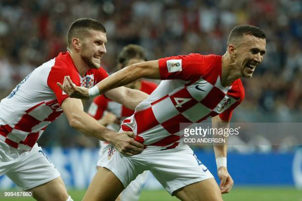 Croatia's forward Ivan Perisic celebrates with his teammate forward Ante Rebic after scoring the 11 equalizer during the Russia 2018 World Cup final...