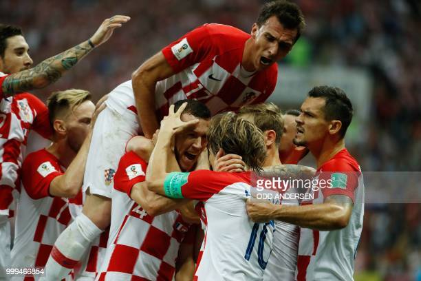 TOPSHOT Croatia's forward Ivan Perisic celebrates with his teammates after scoring the 11 equalizer during the Russia 2018 World Cup final football...
