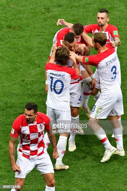 Croatia's forward Ivan Perisic celebrates with his teammates after scoring the 11 equalizer during the Russia 2018 World Cup final football match...