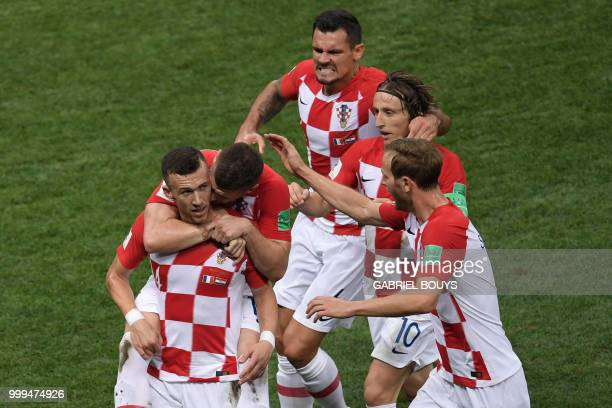 Croatia's forward Ivan Perisic celebrates with teammates after scoring a goal during the Russia 2018 World Cup final football match between France...