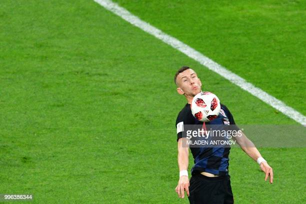 Croatia's forward Ivan Perisic controls the ball during the Russia 2018 World Cup semifinal football match between Croatia and England at the...