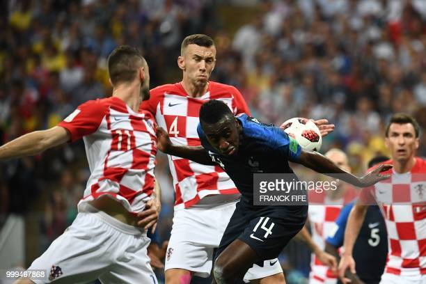 TOPSHOT Croatia's forward Ivan Perisic hits the ball with his hand during their Russia 2018 World Cup final football match between France and Croatia...
