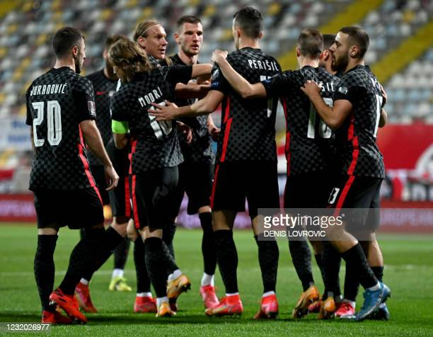 Croatia's forward Ivan Perisic is congratulated by team mates after scoring a goal during qualification football match for the FIFA World Cup Qatar...