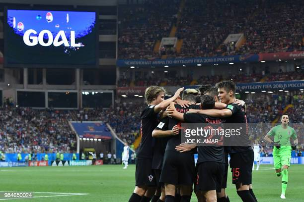 Croatia's forward Ivan Perisic is congratulated by teammates after scoring his team's second goal during the Russia 2018 World Cup Group D football...