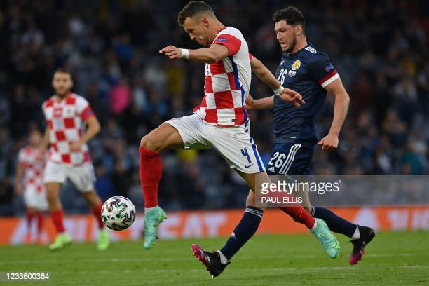Croatia's forward Ivan Perisic is marked by Scotland's defender Scott McKenna during the UEFA EURO 2020 Group D football match between Croatia and...
