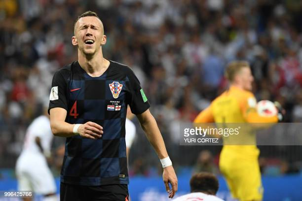 TOPSHOT Croatia's forward Ivan Perisic reacts after missing a goal opportunity during the Russia 2018 World Cup semifinal football match between...