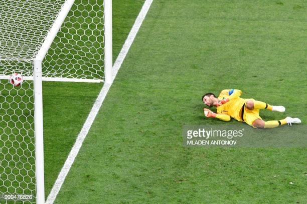 Croatia's forward Ivan Perisic scores the 11 equalizer past France's goalkeeper Hugo Lloris during the Russia 2018 World Cup final football match...