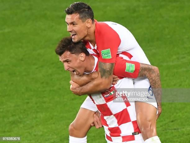 Croatia's forward Mario Mandzukic and Croatia's defender Dejan Lovren celebrate an own goal by Nigeria's midfielder Oghenekaro Etebo during the...