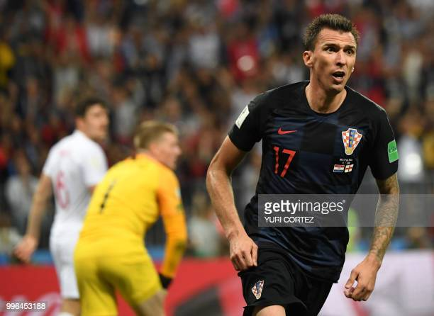 TOPSHOT Croatia's forward Mario Mandzukic celebrates after scoring his team's second goal during the Russia 2018 World Cup semifinal football match...