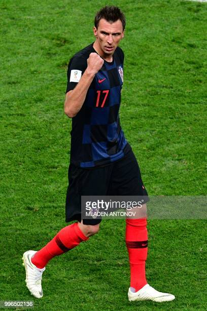 Croatia's forward Mario Mandzukic celebrates after scoring his team's second goal during the Russia 2018 World Cup semifinal football match between...