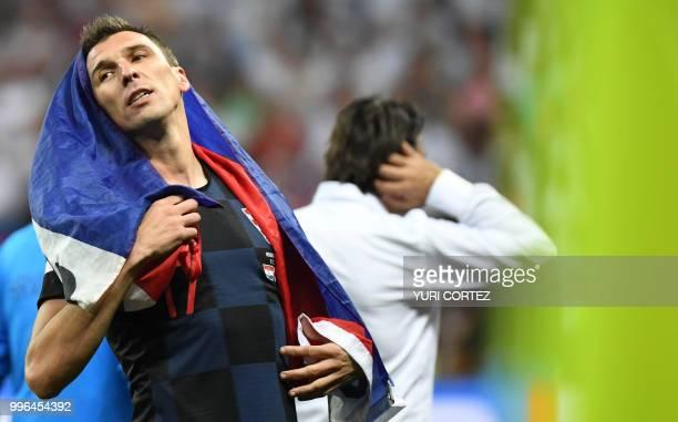 Croatia's forward Mario Mandzukic celebrates at the end of the Russia 2018 World Cup semi-final football match between Croatia and England at the...