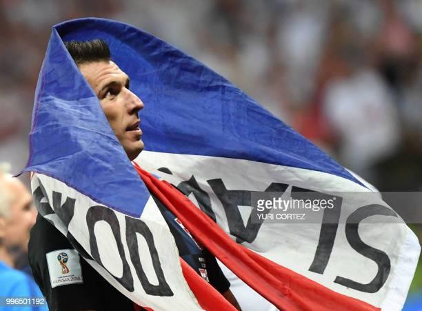 TOPSHOT Croatia's forward Mario Mandzukic celebrates at the end of the Russia 2018 World Cup semifinal football match between Croatia and England at...