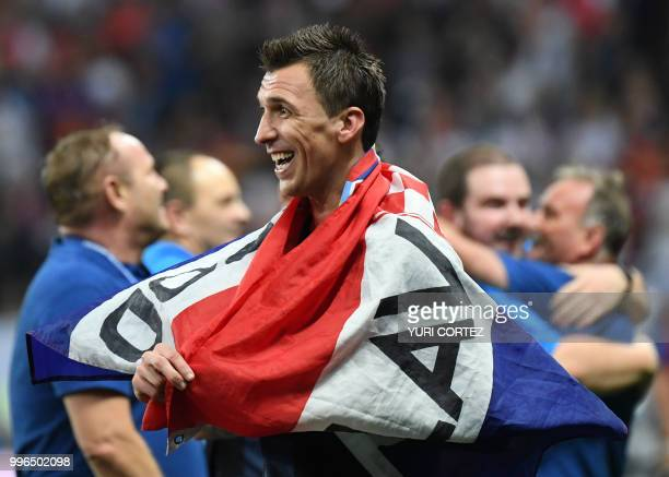 TOPSHOT Croatia's forward Mario Mandzukic celebrates at the end of the Russia 2018 World Cup semifinal football match between Croatia and England at...