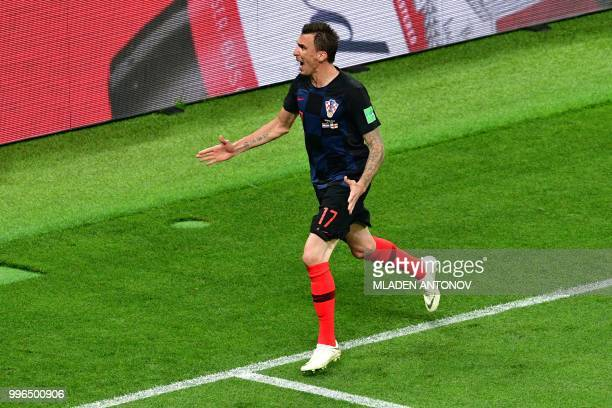 Croatia's forward Mario Mandzukic celebrates scoring their second goal during the Russia 2018 World Cup semifinal football match between Croatia and...