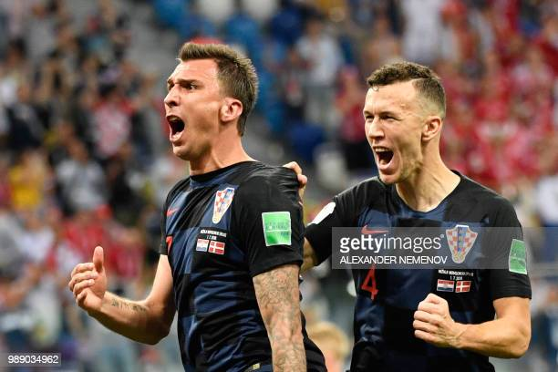 TOPSHOT Croatia's forward Mario Mandzukic celebrates with Croatia's forward Ivan Perisic after scoring the team's first goal during the Russia 2018...