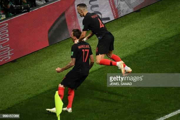 Croatia's forward Mario Mandzukic celebrates with Croatia's forward Ivan Perisic after scoring his team's second goal during the Russia 2018 World...