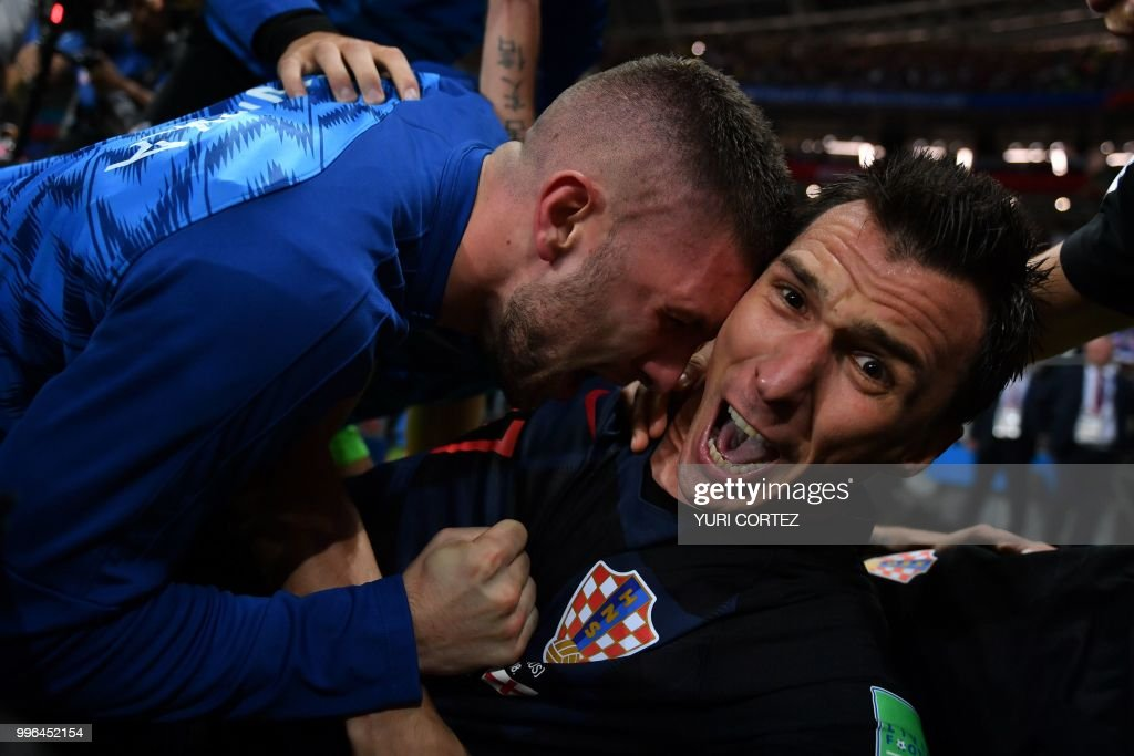 Keep Shooting: Photographer Captures Croatia Celebration From Under the Pile