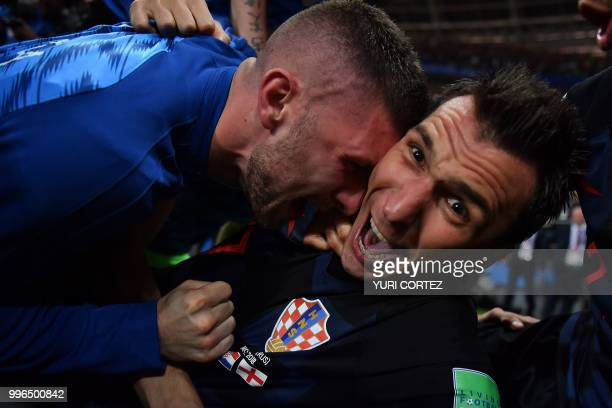 TOPSHOT Croatia's forward Mario Mandzukic celebrates with teammates after scoring his team's second goal during the Russia 2018 World Cup semifinal...