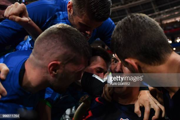 Croatia's forward Mario Mandzukic celebrates with teammates after scoring their second goal during the Russia 2018 World Cup semifinal football match...