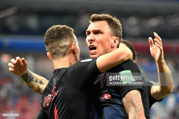 TOPSHOT Croatia's forward Mario Mandzukic celebrates with teammates after scoring the team's first goal during the Russia 2018 World Cup round of 16...
