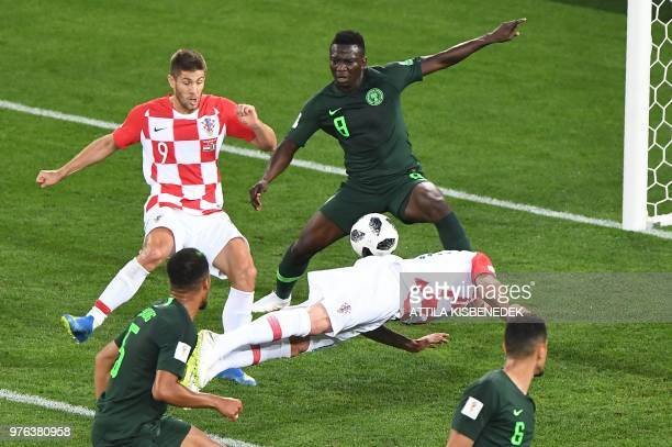 Croatia's forward Mario Mandzukic dives and Nigeria's midfielder Oghenekaro Etebo scores an own goal during the Russia 2018 World Cup Group D...
