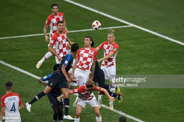 TOPSHOT Croatia's forward Mario Mandzukic heads the ball and scores an own goal after France's forward Antoine Griezmann shot a free kick during the...
