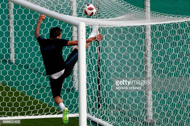 Croatia's forward Mario Mandzukic kicks a ball over the net during a training session at the Luzhniki Stadium training field in Moscow on July 14,...