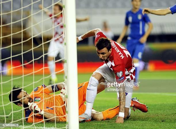 Croatia's forward Mario Mandzukic scores a goal past Italy's goalkeeper Gianluigi Buffon during the Euro 2016 qualifying football match between...