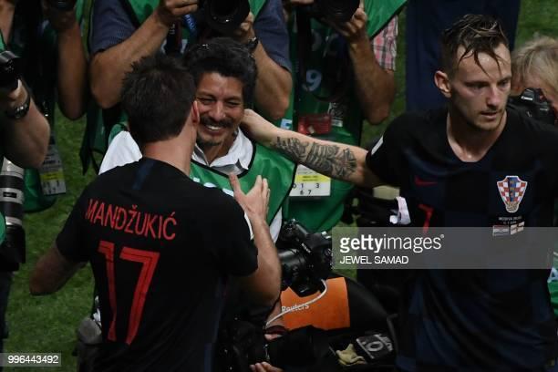Croatia's forward Mario Mandzukic speaks to AFP photographer Yuri Cortez after falling on him with teammates while celebrating scoring his team's...