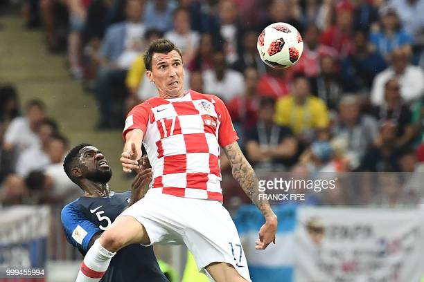 TOPSHOT Croatia's forward Mario Mandzukic vies with France's defender Samuel Umtiti during their Russia 2018 World Cup final football match between...