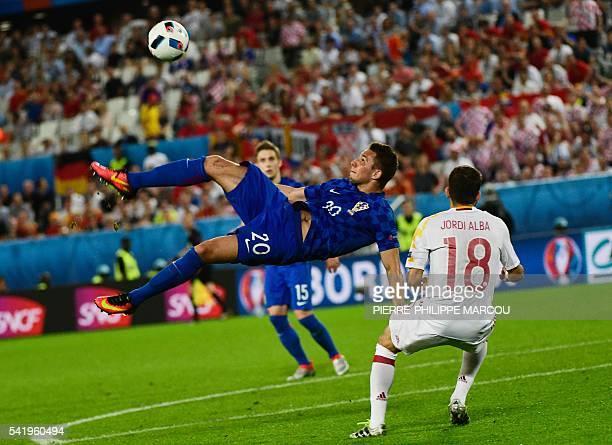 TOPSHOT Croatia's forward Marko Pjaca attempts an overhead kick during the Euro 2016 group D football match between Croatia and Spain at the Matmut...