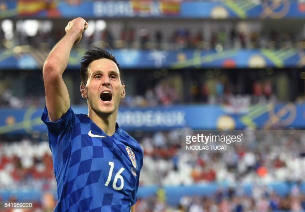 Croatia's forward Nikola Kalinic celebrates after scoring his team's first goal during the Euro 2016 group D football match between Croatia and Spain...