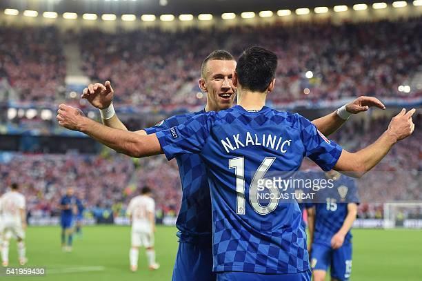 Croatia's forward Nikola Kalinic celebrates with Croatia's midfielder Ivan Perisic after scoring his team's first goal during the Euro 2016 group D...