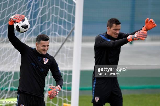 Croatia's goalkeeper Danijel Subasic and Croatia's goalkeeper Lovre Kalinic attend a training session at the Roschino Arena outside Saint Petersburg...