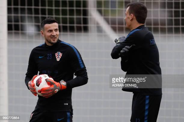 Croatia's goalkeeper Danijel Subasic and Croatia's goalkeeper Lovre Kalinic takes part in a training session in in Sochi on July 3 ahead of the...