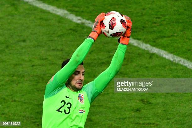 Croatia's goalkeeper Danijel Subasic catches the ball during the Russia 2018 World Cup semifinal football match between Croatia and England at the...