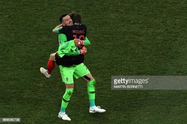 TOPSHOT Croatia's goalkeeper Danijel Subasic celebrate with Croatia's midfielder Luka Modric at the end of the Russia 2018 World Cup round of 16...