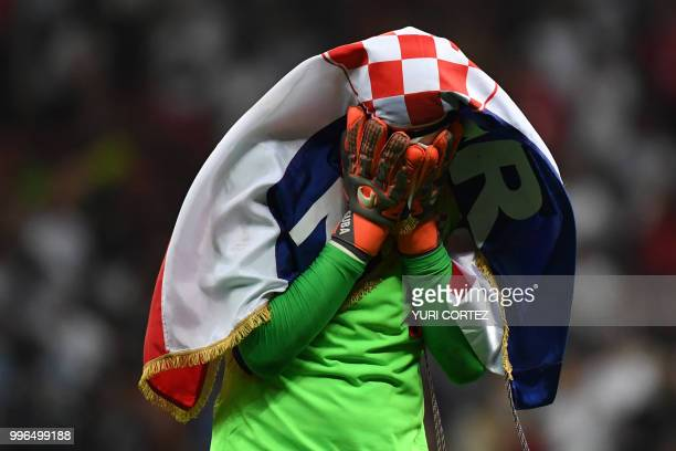 TOPSHOT Croatia's goalkeeper Danijel Subasic celebrates at the end of the Russia 2018 World Cup semifinal football match between Croatia and England...