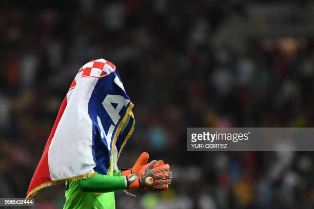 Croatia's goalkeeper Danijel Subasic celebrates at the end of the Russia 2018 World Cup semifinal football match between Croatia and England at the...