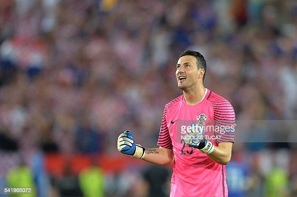 Croatia's goalkeeper Danijel Subasic celebrates following his team's 21 victory in the Euro 2016 group D football match between Croatia and Spain at...