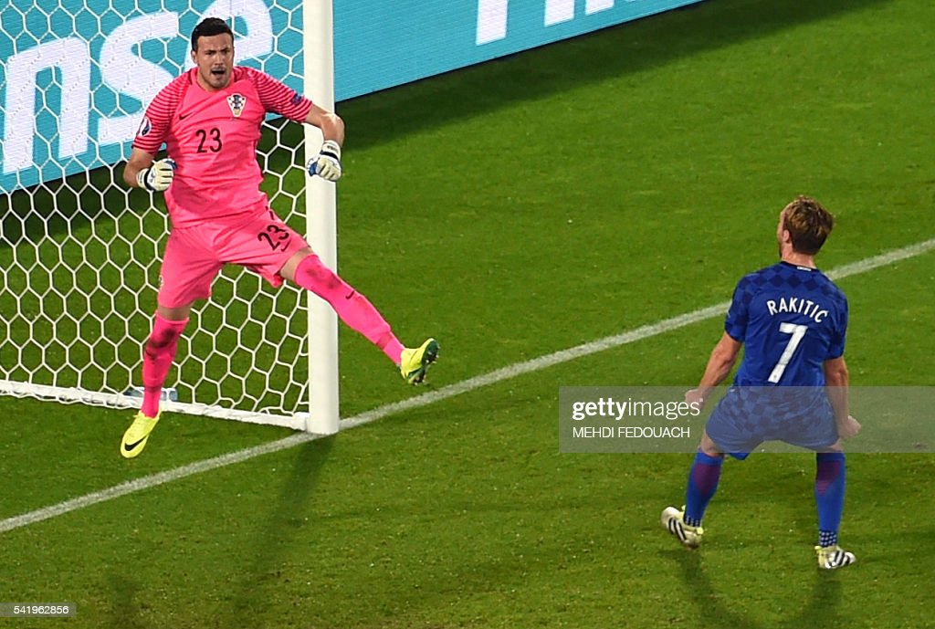 Croatia's goalkeeper Danijel Subasic (L) celebrates his penalty save during the Euro 2016 group D football match between Croatia and Spain at the Matmut Atlantique stadium in Bordeaux on June 21, 2016. / AFP / Mehdi FEDOUACH