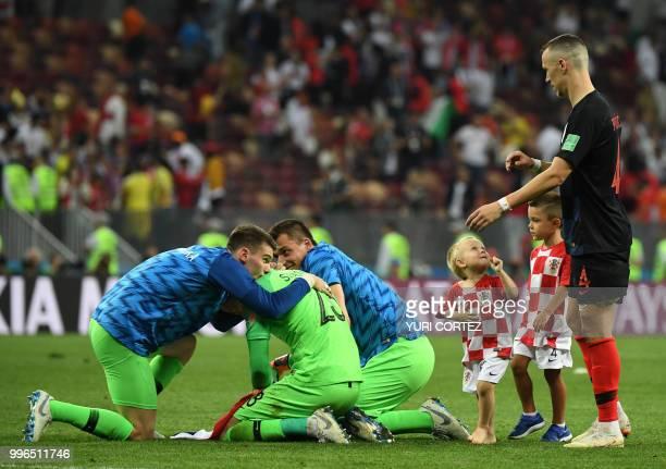 Croatia's goalkeeper Danijel Subasic celebrates with Croatia's goalkeeper Dominik Livakovic and Croatia's goalkeeper Lovre Kalinic next to Croatia's...
