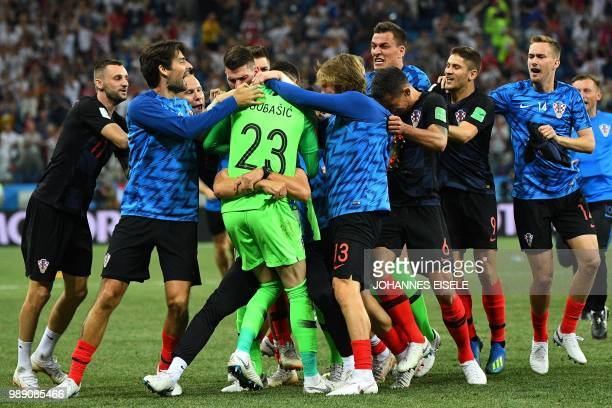 Croatia's goalkeeper Danijel Subasic celebrates with teammates after Croatia won the penalty shootout at the end of the Russia 2018 World Cup round...