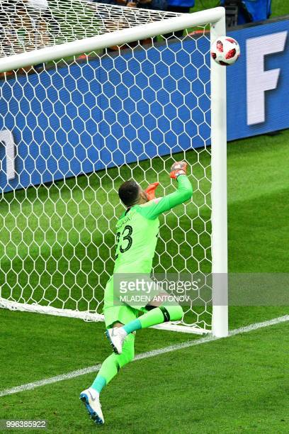 Croatia's goalkeeper Danijel Subasic dives and takes the opening goal during the Russia 2018 World Cup semifinal football match between Croatia and...