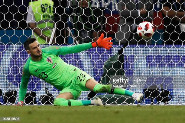 Croatia's goalkeeper Danijel Subasic dives to save a penalty from Russia's forward Fedor Smolov during the Russia 2018 World Cup quarterfinal...